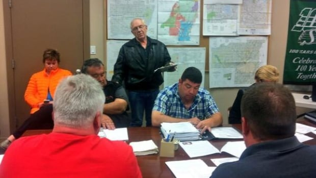 Doug Canning, back centre, says the town administrator sold him six licenses for his pets.