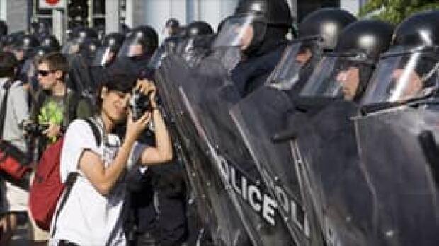 tp-toronto-100626-cp-protester-riot-police