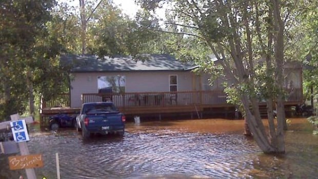 Flood waters in Patricia Beach Provincial Park north of Winnipeg forced homeowners to use ATVs to get around after flooding in 2010. The RM of St. Clements declared a state of local emergency for the resort community late Friday, due to concerns about high winds and waves on the lake.