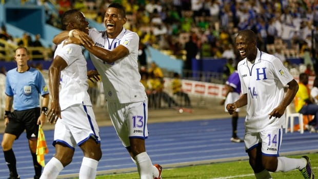 Honduras' Maynor Figueroa, left, celebrates with teammates Carlos Costly, centre, and Garcia Oscar after scoring the team's second goal in a win against Jamaica in their 2014 World Cup qualifying soccer match in Kingston on Tuesday.
