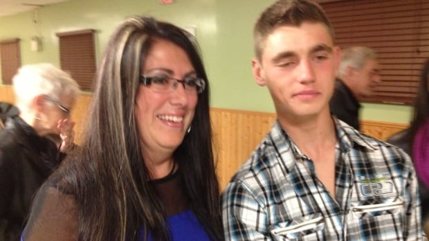 Donna Stacey smiles as she meets Johnathan Bixby, now 18, for the first time since she helped save his life.