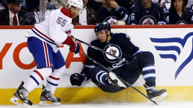 Montreal Canadiens' Francis Bouillon trips up Winnipeg Jets' Blake Wheeler during the second period of their game in Winnipeg on Tuesday.