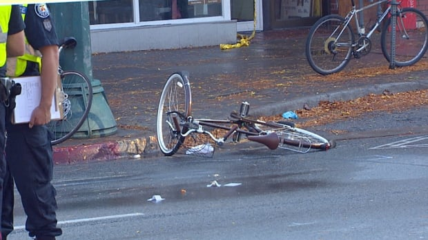 Toronto police say a cyclist succumbed to her injuries on Sunday, just four days after she was pinned under a truck on Spadina Avenue.