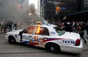 w-g20-burning-police-car-cp-8947483