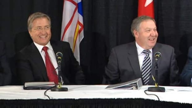 Newfoundland and Labrador Premier Danny Williams, left, and N.S. Premier Darrell Dexter announced terms of a deal to develop hydroelectric power in Labrador and transmit it at least as far as Nova Scotia.