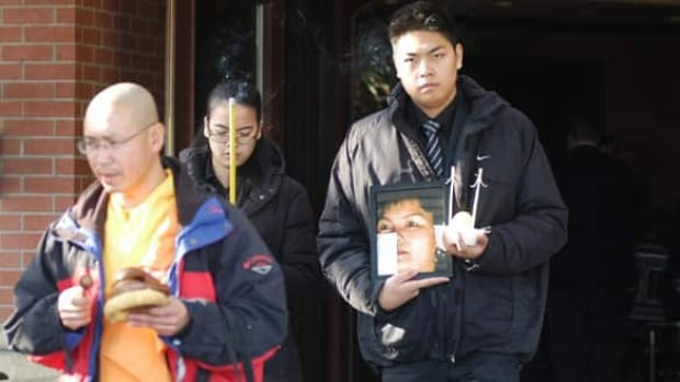 Jennifer Pan, centre, is shown carrying incense at her mother's funeral.