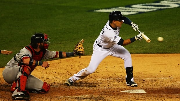 Jose Iglesias of the Tigers bunts in a 7-3 victory over the Red Sox in Game 4 of the ALCS at Comerica Park on Wednesday.