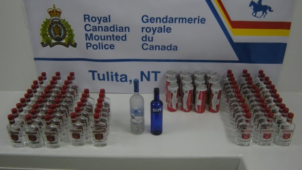 Three people are facing charges after RCMP in Tulita, N.W.T., seized 77 bottles of vodka and 12 cans of beer on Saturday in the alcohol-restricted community.