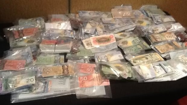 A joint investigation involving Ontario and Quebec provincial police netted $409,000 cash after a series of warrants were executed Wednesday, Oct. 16, 2013.