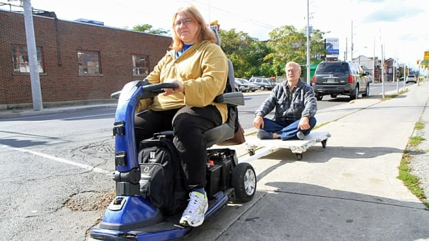 Married couple Diane and David Nevin have been using this scooter and trailer to get around Hamilton for years. They say the city could do a lot more to make sidewalks more accessible for mobility device users - but in the end, it's all about compromise between walkers and riders.