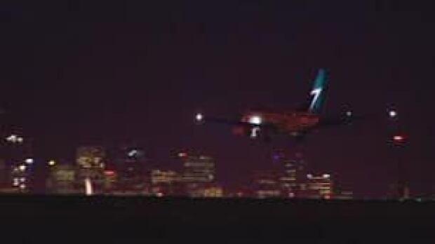 tp-cgy-westjet-plane-night