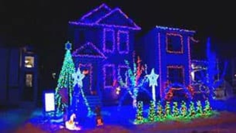 this christmas lights display at a home in northeast calgary is synchronized to christmas tunes played through passing cars radios via a low power fm