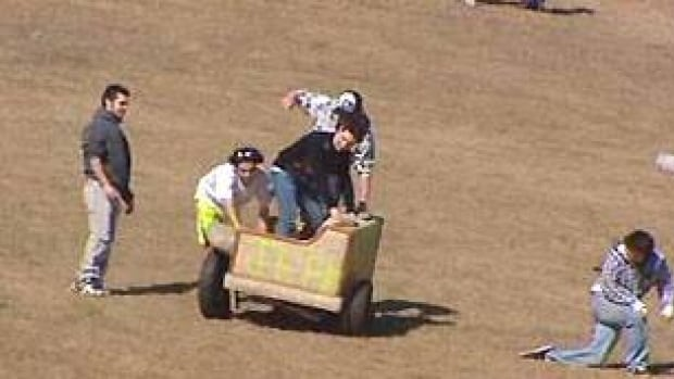 Students at the University of Calgary celebrate the last day of classes by modifying couches to race down a hill.