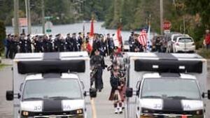 bc-101106-memorial-march-ambulances