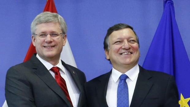 Prime Minister Stephen Harper, left, poses with European Commission President Jose Manuel Barroso ahead of a meeting in Brussels on October 18, 2013. The European Union and Canada closed talks on a multi-billion-dollar trade deal on Friday that will integrate two of the world's biggest economies.