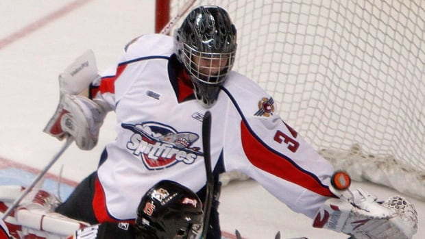 Michael Nishi, seen here playing for the Ontario Hockey League's Windsor Spitfires in 2009, was the first goalie on the ice at Maple Leafs practice Friday. Nishi, who now plays for the University of Toronto, joined the NHL team's workout in case netminder James Reimer was forced to leave early after injuring himself in Thursday's loss to Carolina.