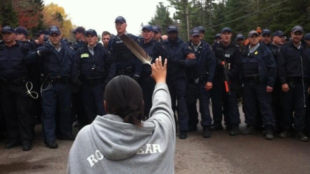 Tensions flared as the police line advanced on protesters in Rexton, N.B., on Oct. 17. This image of Amanda Polchies, kneeling with a feather raised in front of the RCMP, was retweeted and reworked countless times, becoming an iconic image of 2013.
