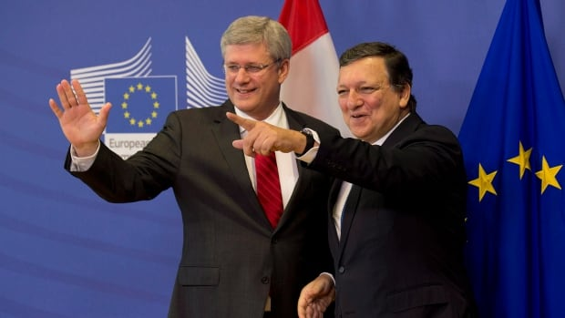 Prime Minister Stephen Harper, left, and President of the European Commission Jose Manuel Barroso reach agreement on the trade deal Oct. 18, 2013, but a final text is still in the works.