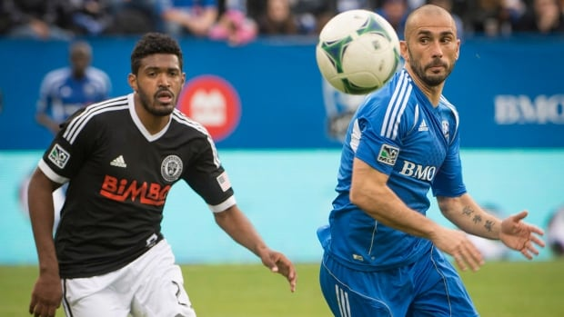 Montreal Impact's Marco Di Vaio is dogged by Philadelphia Union's Sheanon Williams in Montreal on Saturday.