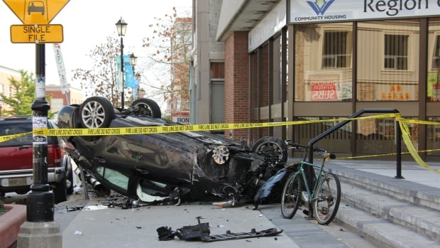 The driver of the pictured car has been identified as Anton Radisic, 38, of Oakville. Waterloo Regional Police say Radisic was stabbed on Harold Avenue, Kitchener minutes before a crash on King Street East near Eby Street.