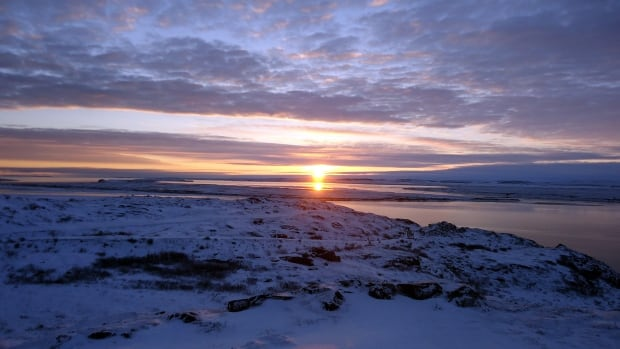 Sunrise in Kugluktuk, Nunavut. The hamlet's emergency siren now sounds at 8:30 a.m. every school day to get the kids out of bed and into class.