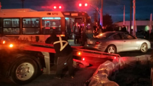A car that failed to stop at a red light collided with a Rapibus early Monday morning during the new public transportation system's first weekday rush hour run. (October 21, 2013)