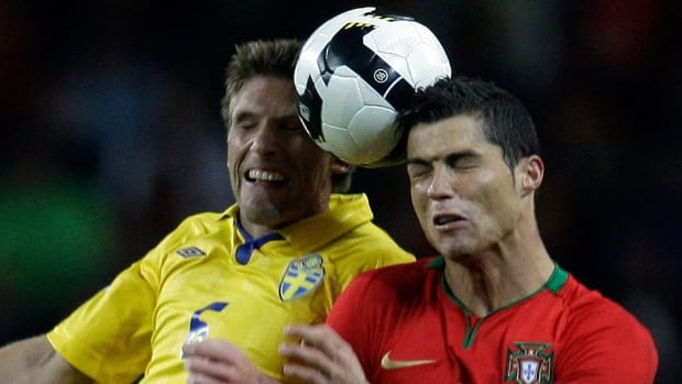Sweden's Anders Svensson, left, jumps for the ball with Portugal's Cristiano Ronaldo during their 2010 World Cu qualifying match. They'll meet again next month in a two-leg playoff to determine who will advance to the 2014 tournament in Brazil.