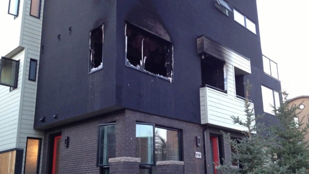 Officials are questioning a man about a suspicious early morning fire at a newly constructed condo complex in southwest Calgary on Monday.