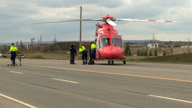 A man was airlifted to a Hamilton hospital on Monday afternoon, after spending several hours trapped under a cement truck in Oakville, Ont.