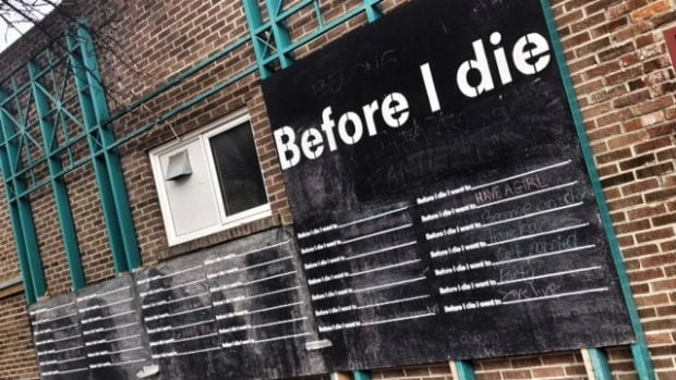 Before I die wall on Spence Neighbourhood Association building at corner of Ellice and Maryland in Winnipeg.