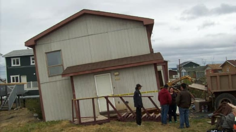Inuvik house tips from pilings | CBC News