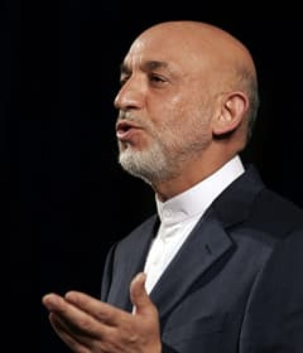 karzai-speaks-cp-7146315