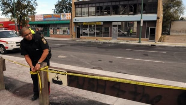 Winnipeg police tape off the area around the Aquarius Bath House on Notre Dame Avenue in October 2009, after a fire broke out and killed two people.