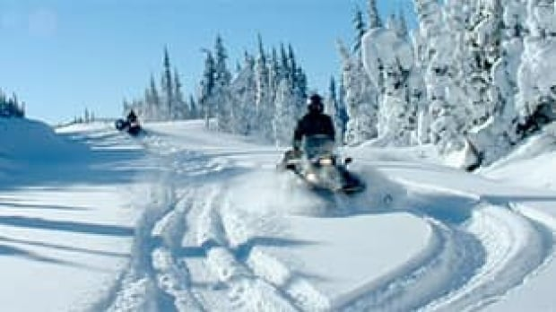 bc-091110-snowmobilers