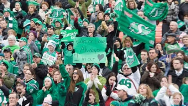 A crowd of cheering Saskatchewan Roughriders fans welcomed back their team Monday at Mosaic Stadium in Regina, Sask. The Riders lost to the Montreal Alouettes in Sunday's Grey Cup game in Calgary.