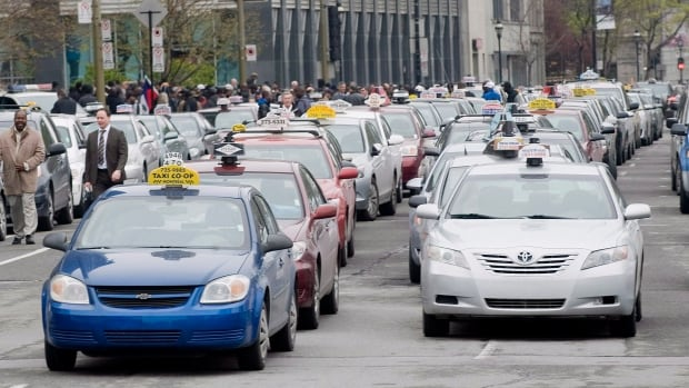 Taxi companies in Montreal and Toronto say the Uber app is unfairly taking away their business.