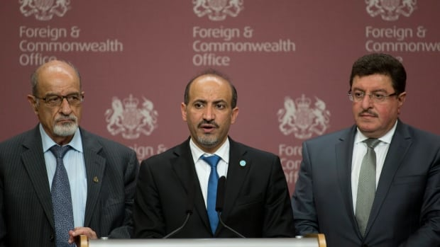 Members of the Syrian Opposition Coalition, including the group's president, Ahmed Jarba, centre, say the group won't attend peace talks to end the Syrian civil war unless there is a clear timeframe for President Bashar al-Assad to leave power. (Alastair Grant/Associated Press)