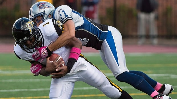 Alouettes linebacker Chip Cox, top, Cox had six tackles, another tackle on special teams, and two quarterback sacks in a 36-5 win over Hamilton on Sunday.
