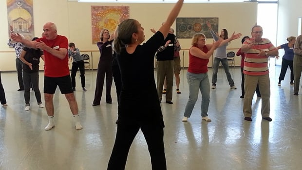 Angie Seto, an instructor at the National Ballet School, leads a Dancing with Parkinson's class on Tuesday. Dance therapy classes seem to improve short-term motor skills in people with Parkinson's disease but researchers don't understand why.