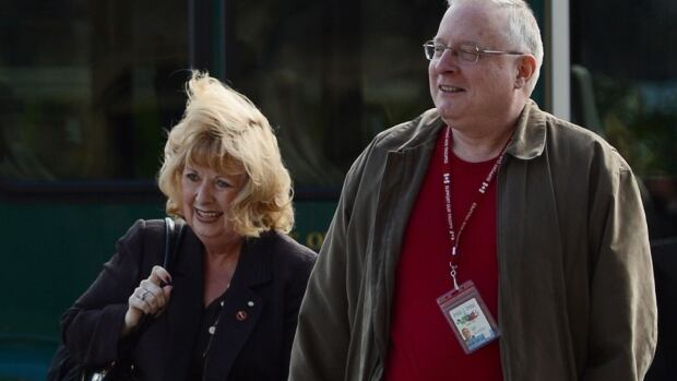 Senator Pamela Wallin arrives with her assistant Mark Fisher on Parliament Hill in Ottawa on Tuesday for a debate on whether she should be suspended from the Senate without pay. Debate was later adjourned until Wednesday.