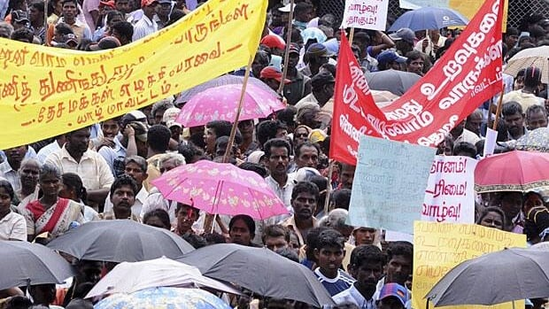 Sri Lankan ethnic Tamils hold banners and placards with messages to save their relatives in Wanni, during a demonstration in Jaffna peninsula, Sri Lanka, Sunday, Feb. 1, 2009.
