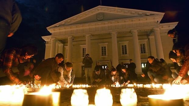 People light candles in front of the town hall in Vilnius, Lithuania after lights were switched off for Earth Hour 2010. Now in its fifth year, Earth Hour 2011 will feature the participation of 131 countries.