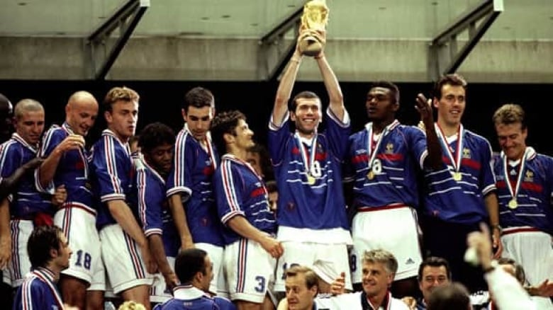 199d018b213 Zinedine Zidane lifts the trophy after France s victory over Brazil in the  1998 World Cup final. ((Ben Radford Allsport))