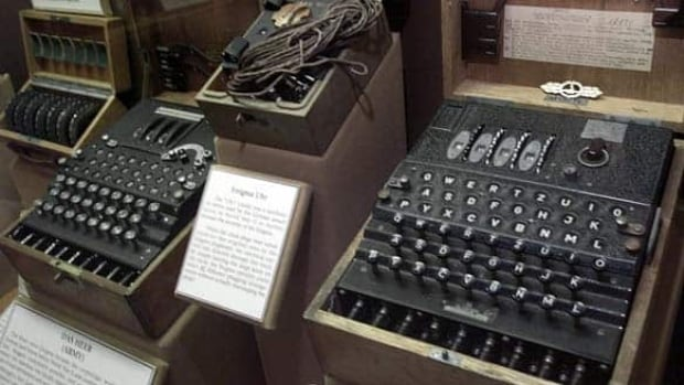A June 25, 2002, file picture shows a four-rotor Enigma machine, right, once used by the crews of German U-boats in the Second World War to send coded messages, which British mathematician Alan Turing was instrumental in breaking.