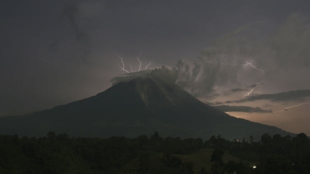 Mount Sinabung began erupting last month after lying dormant for three years. On Thursday, it erupted again as people who had been forced out of their homes by the first explosion were returning home. The latest eruption forced 3,300 people to flee their homes.