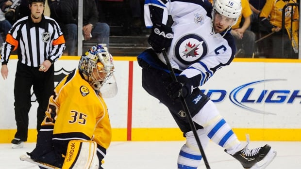 Andrew Ladd, right, and his Jets teammates have caught a break and won't face Predators starting goalie Pekka Rinne, left, on Thursday. Rinne has a bacterial infection in his hip and expected to miss one month of action.