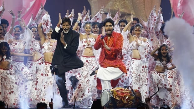 Stars Amitabh Bachchan, left, and his son Abhishek Bachchan perform on stage at the International Indian Film Academy Awards in Sheffield, England in 2007.