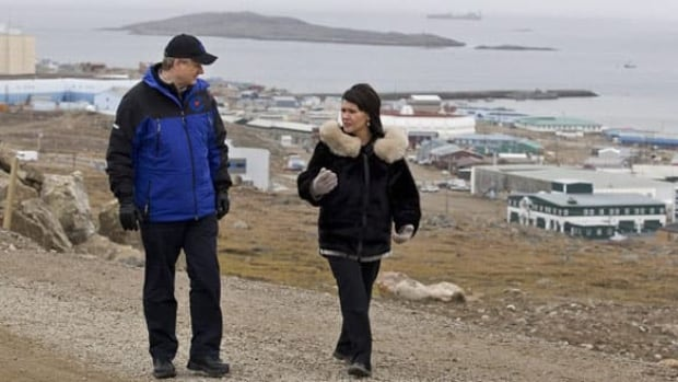 Leona Aglukkaq walks with Conservative Leader Stephen Harper in Iqaluit in September 2008. Stephen Harper will be in Whitehorse August 21 to meet with the local Conservatives. There's speculation he'll also make stops in the N.W.T.