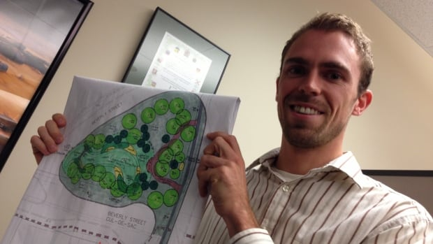 Lee Amelia, an urban forestry specialist with the City of Thunder Bay, holds a map showing the stormwater retention site at Beverley and High Streets.