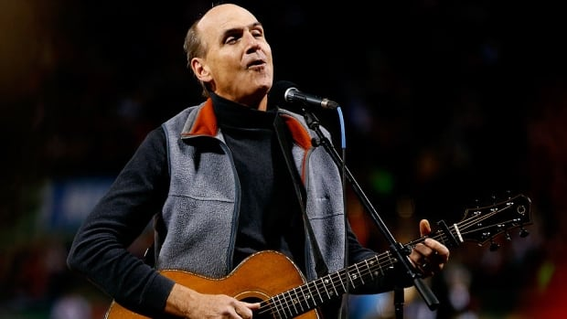 James Taylor sings the U.S. national anthem prior to Game 2 of the World Series on Thursday night in Boston. Taylor flubbed the start and began singing America The Beautiful before correcting himself.